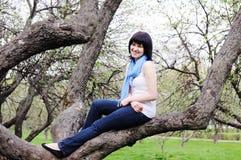 Girl on a tree Royalty Free Stock Photos