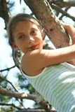 Girl on the tree Stock Photos