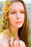 Girl with a tree branch Royalty Free Stock Photo