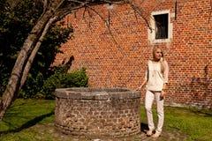 Free Girl Tree Brick Stone Wall Well, Groot Begijnhof, Leuven, Belgium Stock Image - 127642091