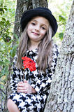 Girl, Tree and Red Flower Stock Images
