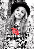 Girl, Tree and Red Flower Stock Photo