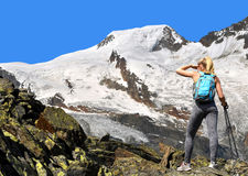 Girl on a trek in the Swiss Alps. In the background mountain Alphubel, Switzerland Stock Photo