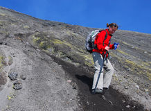 Girl trekking on Etna volcano Royalty Free Stock Images