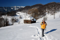 Girl trekking in winter mountains, Romania Royalty Free Stock Images