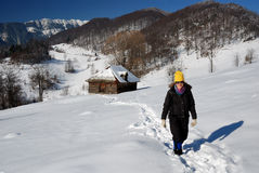 Girl trekking in winter mountains, Romania Royalty Free Stock Photography