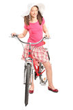 Girl with a trendy hat posing on a bike Royalty Free Stock Photo