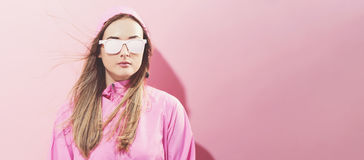 Girl in trendy painted glasses in pink jacket stock photos