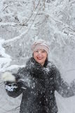Girl treset snowy tree branch. Girl in winter forest, snow-covered tree branches treset Stock Images