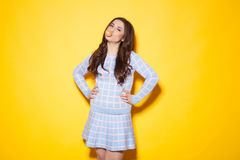 Girl tricked bubble of chewing gum. Girl in a blue dress chews gum Royalty Free Stock Image