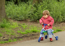Girl on a tricycle Stock Image