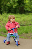 Girl on a tricycle Royalty Free Stock Images