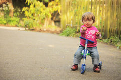 Girl on a tricycle Stock Photo