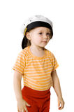 Girl tries on a cap Royalty Free Stock Photography