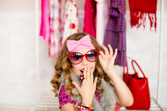 The girl tries on clothes Royalty Free Stock Image