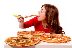 Girl tries different kinds of pizza. Girl tries three different kinds of pizza stock images