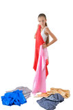 The girl tries on fabric. The girl tries on multi-colored fabric Royalty Free Stock Photo