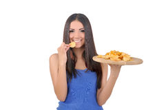 Girl tries golden chips Royalty Free Stock Image