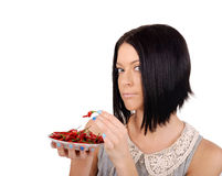 Girl tries red pepper Royalty Free Stock Photo