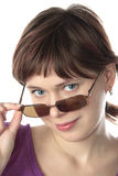 Girl tries sun glasses Stock Images