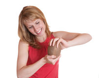 The girl tries to break coconut Royalty Free Stock Photography
