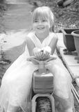 Girl on Trike. A black and white image of a happy, smiley girl sat on a trike Stock Photography