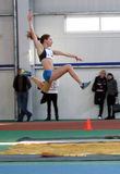 Girl on the triple jump Stock Images