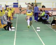 Girl on the triple jump Stock Photo