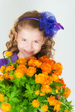 The girl with  trollius Royalty Free Stock Photo
