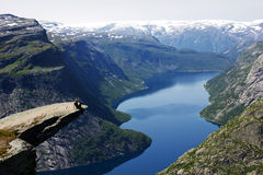 Girl in trolltunga Royalty Free Stock Photography