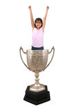 Girl in Trophy Cup. A photo of a girl celebrating inside a trophy cup royalty free stock images