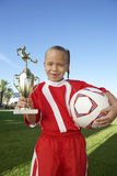 Girl With Trophy And Soccer Ball Stock Image