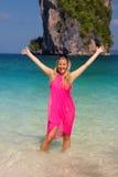 Girl on tropical beach. Girl on tropical island with huge rock on the horizon stock photos