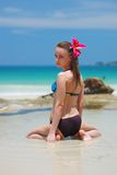 Girl on a tropical beach Royalty Free Stock Image