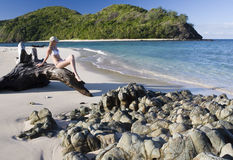 Girl on a tropical beach in Fiji - South Pacific. Teenage girl in a bikini on a tropical beach in Fiji in the South Pacific Stock Photo