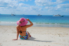 Girl on a tropical beach with hat Royalty Free Stock Images
