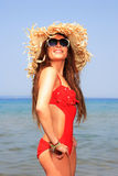 Girl on a tropical beach with hat Royalty Free Stock Photo