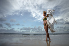 Girl on tropical beach Royalty Free Stock Image