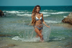 Girl on tropical beach. Young adult  girl on tropical beach with splash Royalty Free Stock Images