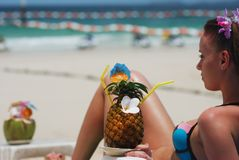 Girl with tropical cocktail Stock Image