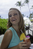 Girl with tropical drink. Young woman with tropical drink at a hawaii resort royalty free stock photos