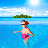 Girl in tropical environment Stock Photography