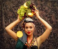 A girl with tropical fruit.