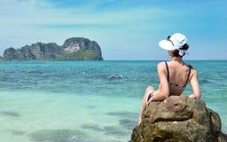 Girl on the rock bamboo island Stock Photos