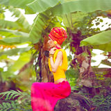 Girl in a tropical jungle Stock Images