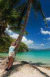 Girl in a tropical paradise Stock Image
