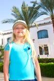 Girl among tropical plants Stock Images