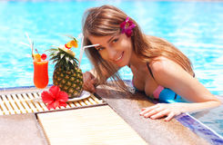 Girl in tropical pool Stock Photography