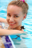 Girl in tropical pool Stock Photos