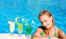 Girl in tropical pool Royalty Free Stock Photography